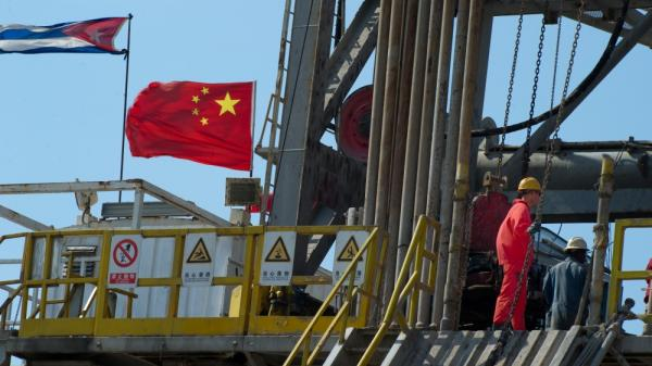 Employees work on an oil rig operated by Cuba and China in Havana in April. A Chinese-built rig is expected to begin drilling exploratory wells off Cuba's northwest coast as early as November, raising environmental concerns in the U.S.