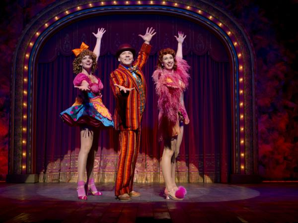 "<strong>Blue man, grouped:</strong> Buddy Plummer (Danny Burstein, with Jenifer Foote and Kiira Schmidt) gets to bust loose at last with ""Buddy's Blues"" in the show's final sequence, known as Loveland."