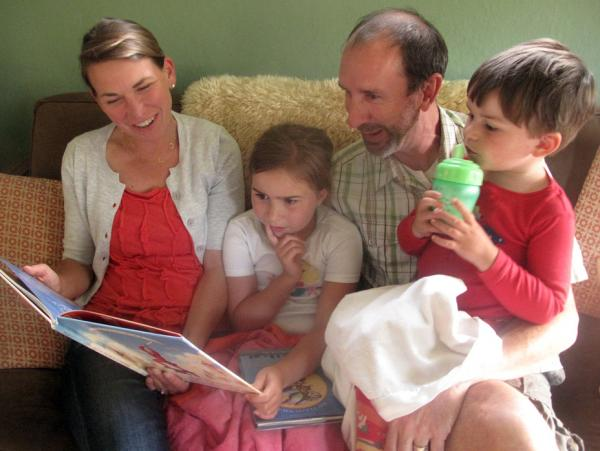 """For Stephanie Upp, shown here with her husband, Ben Corson, with their two children, Clare and Calder, there was """"never a question that I would have a richer life than I grew up with."""""""