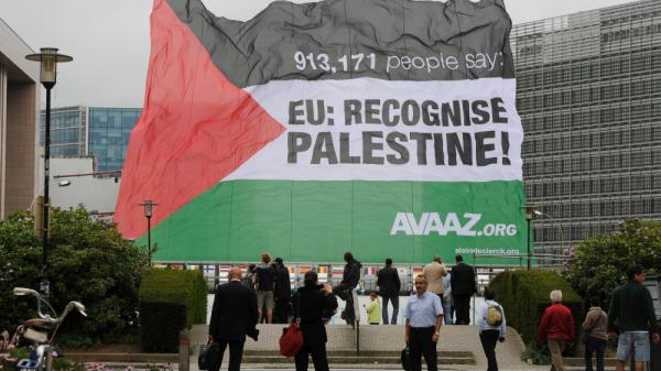 A Palestinian flag is raised in front of European Union headquarters in Brussels, Belgium, on Monday. The Palestinians are expected to seek statehood at the United Nations next week.