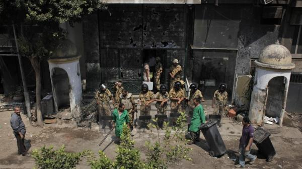 Egyptian soldiers guard the badly damaged entrance of the Israeli Embassy in Cairo, Egypt on Sunday. Protesters stormed the embassy, contributing to the worst diplomatic crisis between the two countries since they signed a peace treaty in 1979.