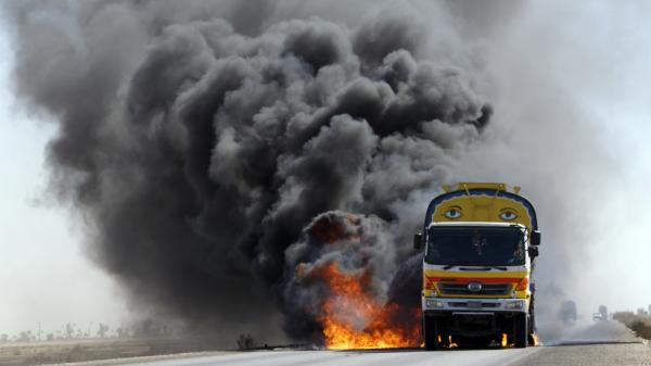 For the first seven years of the Afghanistan war, almost all U.S. and NATO supplies were trucked overland to Afghanistan through parts of Pakistan effectively controlled by the Taliban. Here, smoke and flame rise from a burning NATO supplies oil tanker after armed militants torched the tankers  in Mithri, Pakistan, Feb. 7.