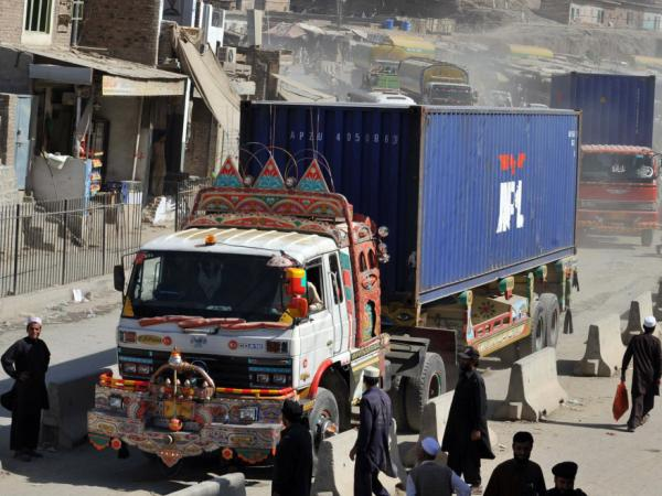 Trucks and tankers carrying supplies for NATO forces in Afghanistan arrive at the Pakistan's Torkham border crossing point before entering into Afghanistan on Oct. 10, 2010. The U.S. is increasingly relying on alternate routes that bypass Pakistan altogether.