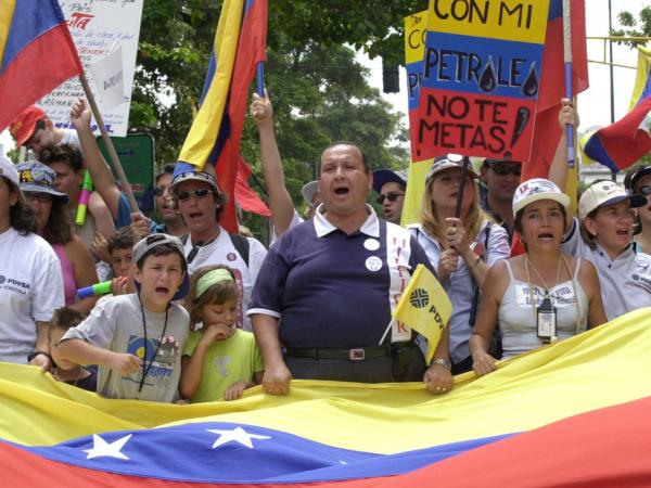 Oil workers in Venezuela took part in strikes and protests in 2002. President Hugo Chavez fired some 20,000 workers.