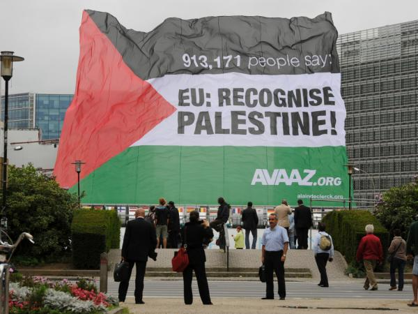 A Palestinian flag is raised in front of European Union headquarters in Brussels on Monday, September 12th. The Palestinians are expected to seek statehood at the United Nations next week.