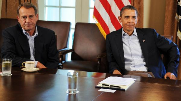 Far apart: House Speaker John Boehner (R-OH) and President Obama in July.