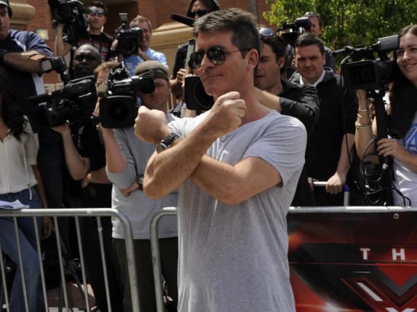 <strong>The spot:</strong> Simon Cowell at the Los Angeles taping of<em> The X Factor,</em> one of many new shows you may not be able to watch this week.