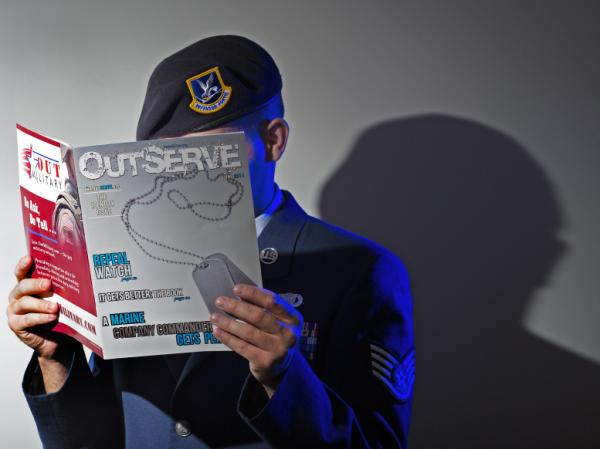 A gay member of the U.S. Air Force who wishes not to be identified reads a copy of the new magazine <em>OutServe</em> intended for actively serving lesbian, gay, bisexual and transgender U.S. military members earlier this month.