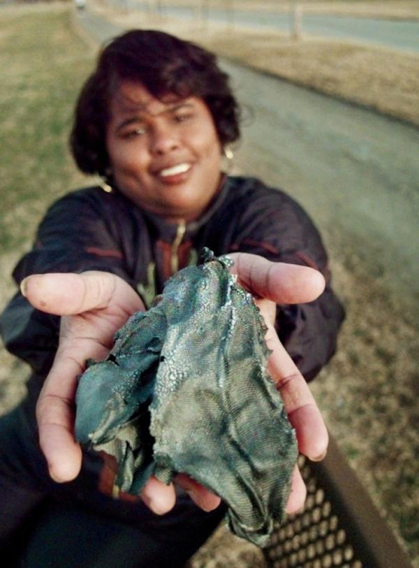 Lottie Williams holds a piece of a Delta II rocket which fell from the sky and hit her in the back while she was on a walking on a trail in Tulsa, Okla, in 1997.