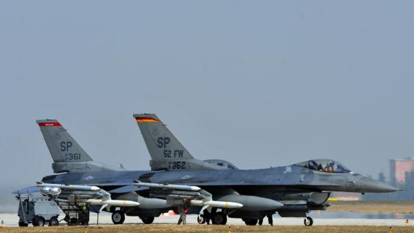 US airforce F16 jet fighters sit on the tarmac at the Aviano air base in Italy on March 25, 2011. It tested its jets on fuel made of 50 percent vegetable oil.