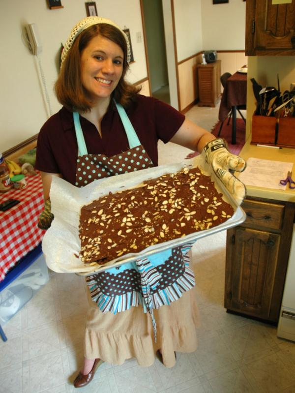 "In deference to Titus 2:3-5 and 1 Timothy 5:14, Rachel Held Evans tried to stay ""busy in  the home,"" honing her cooking, cleaning and hospitality skills. She is seen here with homemade matzah toffee for Passover."