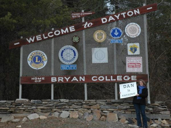 "Proverbs 31:23 says that a virtuous woman's husband is ""respected at the city  gate,"" so Evans made a poster that said ""Dan is Awesome"" and stood in front of  the ""Welcome to Dayton"" sign for 30 minutes one  afternoon."