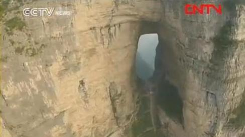 The view from Jeb Corliss' headcam as he flew toward the hole in Tianmen mountain on Saturday.