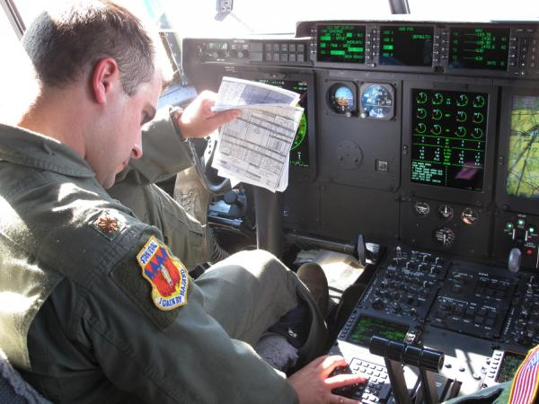 Air Force Major Josh Frey pilots a plane on jet bio fuel. Frey says his  C130 flies the same on 50 percent bio fuel as it does on petroleum.