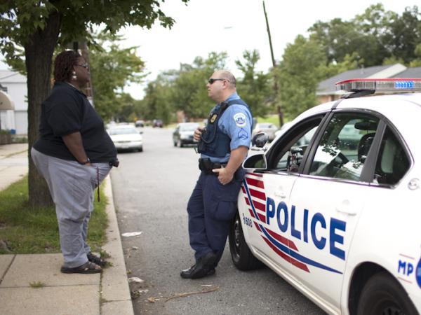 Earline Budd, a transgender advocate, speaks to a D.C. police officer about a spate of attacks in Washington, D.C.