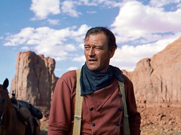 "<p>Actor John Wayne played Ethan Edwards in the 1956 film <em>The Searchers</em>. Critic John Powers says the film star ""was one of the defining Americans of the 20th century.""</p>"