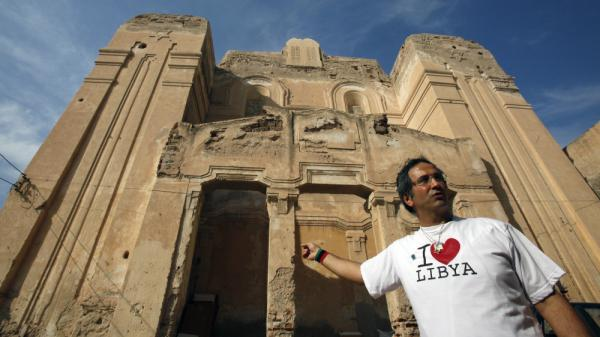 <p>David Gerbi stands in front of the main synagogue in Tripoli, Libya, on Sunday. An exiled Libyan Jew, he has returned after being away for more than 40 years. He hopes to restore the synagogue and create an atmosphere of tolerance following the ouster of Moammar Gadhafi.</p>