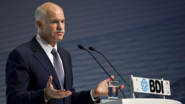 <p>Greek Prime Minister George Papandreou addresses a meeting of the Federation of German Industry in Berlin, Sept. 27. He is the son and grandson of Greek prime ministers, but his critics say he is betraying the work of his father, who built up the Greek welfare state.</p>