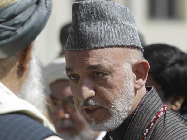 <p>Afghan President Hamid Karzai at the funeral ceremony of slain Afghanistan High Peace Council and former president Burhanuddin Rabbani on Sept. 23, 2011. </p>