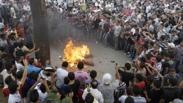 <p>Protesters opposed to Syrian President Bashar Assad burn an effigy of him Friday prayer in the northern city of Tripoli, Lebanon.</p>