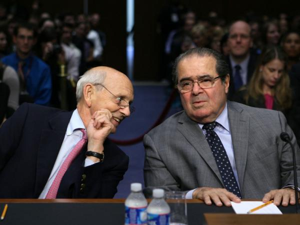 <p>Supreme Court Justices Stephen Breyer (left) and Antonin Scalia testify during a hearing before the Senate Judiciary Committee Wednesday. The justices showed that while they are legal opposites, they are by no means opponents.</p>