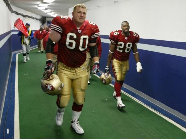 <p>Former San Francisco 49ers offensive lineman Ben Lynch (center). </p>