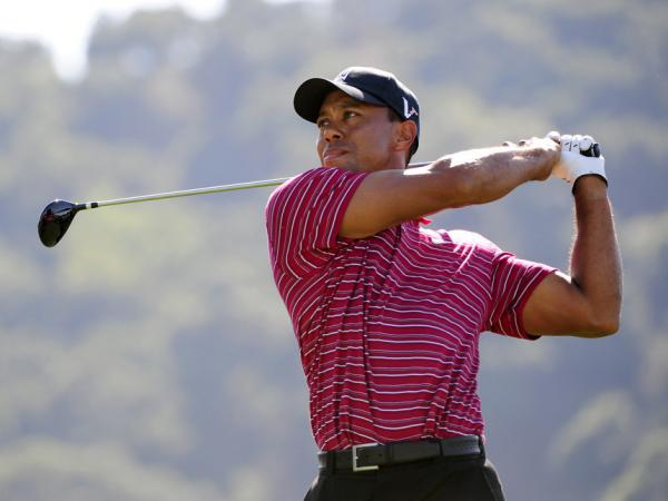 <p>Tiger Woods, hits from the tee on the ninth hole on the final round of the Frys.com Open. Two holes earlier, his birdie putt attempt was interrupted by a man throwing a hot dog onto the green.</p>