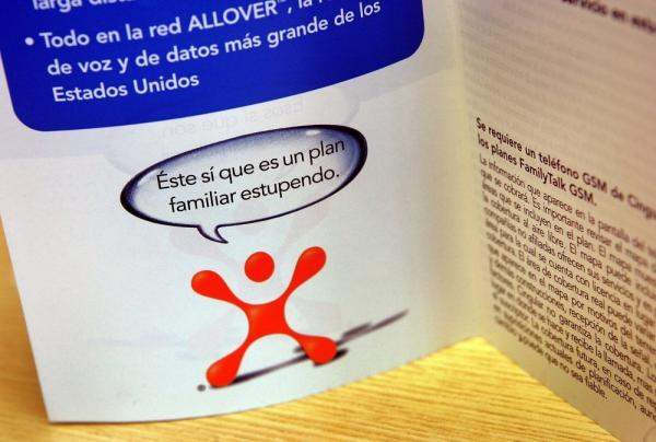 "<p>A pamphlet in Spanish for Cingular phone rate information is displayed in a Cingular store in Elmhurst, Illinois. Cingular announced in 2006 that it was converting 420 of their stores to ""a bilingual concept,"" with both English and Spanish phone information, payment options and bilingual staff members. </p>"