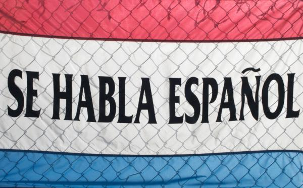 <p>A sign spells out Se Habla Espanol (Spanish Spoken Here). </p>