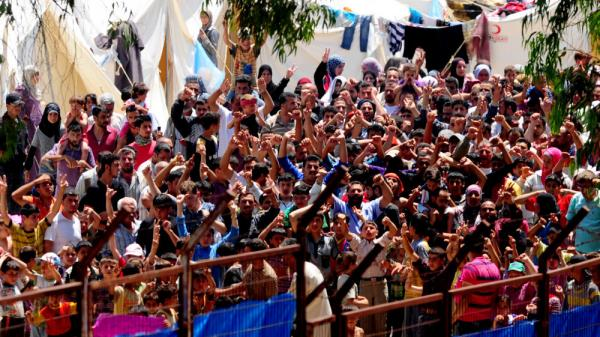 <p>Syrian refugees gather for a protest against Syrian President Bashar Assad at the Turkish Red Crescent camp in the Yayladagi district of the Turkish city of Hatay near the Syrian border, June 20, 2011. More than 7,000 Syrians are living in camps in Turkey.</p>