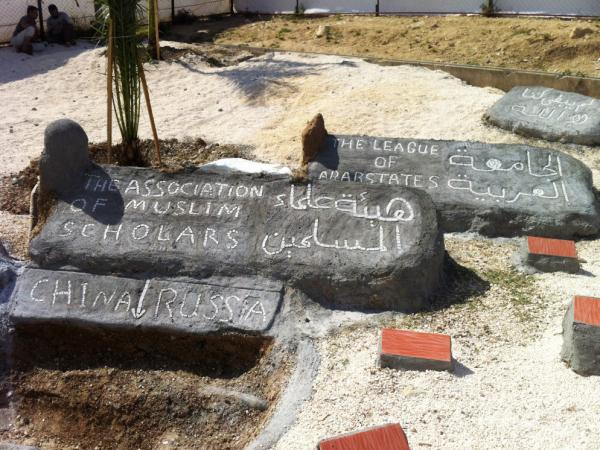 "<p>At the Altinozu camp in southeastern Turkey, the Syrian residents have built a mock graveyard. A freshly dug ""grave"" is for China and Russia, who vetoed a recent U.N. resolution against Syria. Other headstones are for the Arab League and the Association of Muslim Scholars, which have also disappointed the Syrian opposition.</p>"