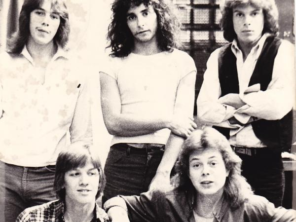 <p>With shaggy hair and skinny jeans, Jon Huntsman (upper right) strikes a pose with his band Wizard. </p>