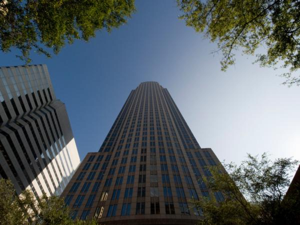 <p>Bank of America's headquarters towers over the city center in Charlotte, N.C. Charlotte has long been one of the fastest-growing regions in the country, but now nearly one in 10 residents is out of work.</p>