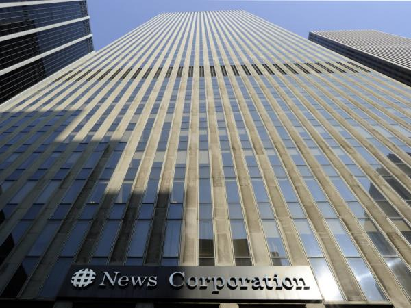<p>The News Corp. headquarters in New York City. The top executive of News Corp.'s <em>Wall Street Journal Europe</em> has resigned over accusations that the paper was involved in a scheme to inflate its circulation numbers.</p>