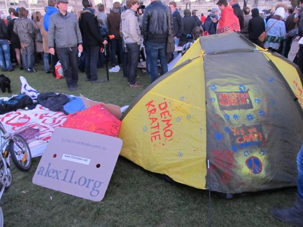 <p>By late Saturday evening, protesters had erected tents or spread out cardboard boxes and iso-mats to sit on. </p>