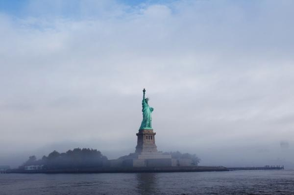 <p>The Statue of Liberty is seen through fog prior to the start of the 125th Anniversary of the Statue of Liberty ceremony on Liberty Island in Sept. 2011. </p>