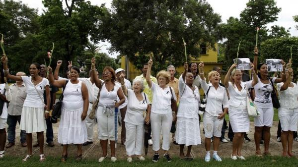 "<p>Members of dissident group Ladies in White yell ""Laura lives!"" during their weekly march in front of Santa Rita church in Havana, Cuba, on Sunday. Cuba's Ladies in White have vowed to keep protesting against the island's communist-run government despite the death of their late founder, Laura Pollan, but the loss presents new challenges for a dissident group already struggling to be visible.</p>"