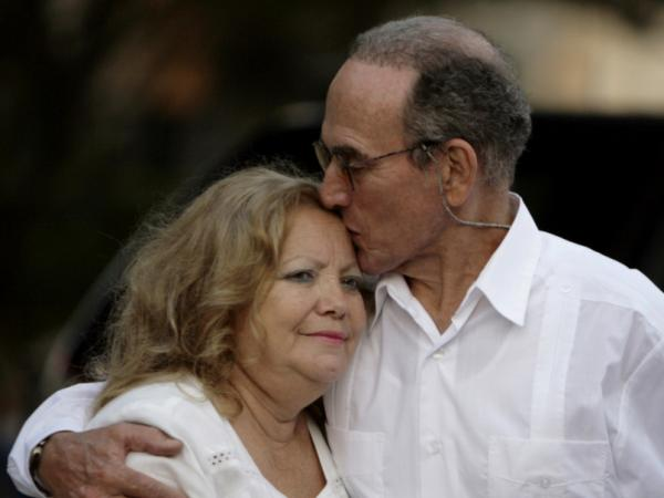 <p>Pollan founded the Ladies in White after her husband, Cuban dissident Hector Maseda, was jailed. He was released in February this year. In this photo from March, Maseda kisses Pollan before a meeting with former U.S. President Jimmy Carter in Havana, Cuba. </p>