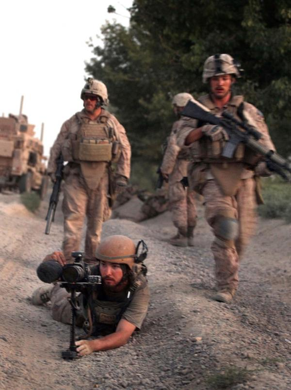 <p>Director Danfung Dennis (bottom left) shot <em>Hell and Back Again</em> in part while embedded with Harris' unit — Echo Company 2nd Battalion, 8th Marine Regiment.</p>