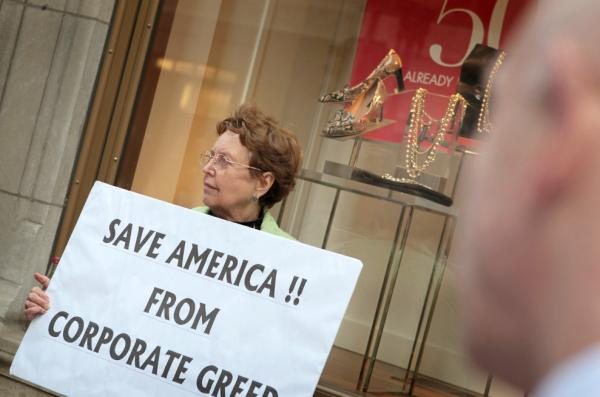 <p>During an Occupy Chicago demonstration at the Bank of America building in Chicago, Kaye Gamble holds a sign protesting corporate greed.</p>