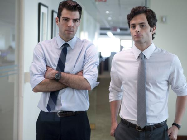 <p><strong></strong>A junior analyst (Zachary Quinto, left) and his colleague (Penn Badgley) find the flaw in the formula that could bring down their company — and the economy.</p>