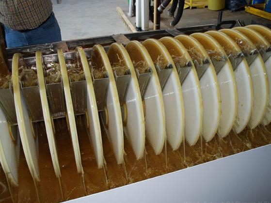 <p>In the winning oil-removal design, spinning grooved discs pull oily water upward, where metal skimmers strain the oil away. </p>