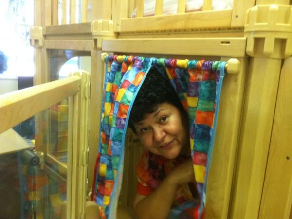 <p>Migrant worker advocate Lourdes Villanueva shows off the most popular playhouse at the Redlands Christian Migrant Association preschool in Mulberry, Fla. Despite the early arrival of kids from Alabama, the school can't open yet because it doesn't have enough money. </p>