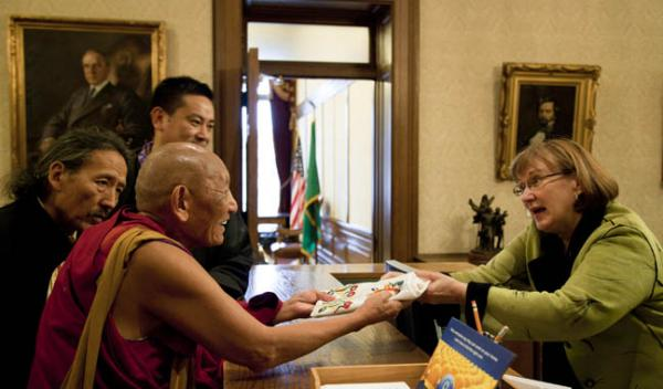 Palden Gyatso, a Tibetan monk, delivers a ceremonial Tibetan scarf to Gov. Gregoire's office in Olympia.