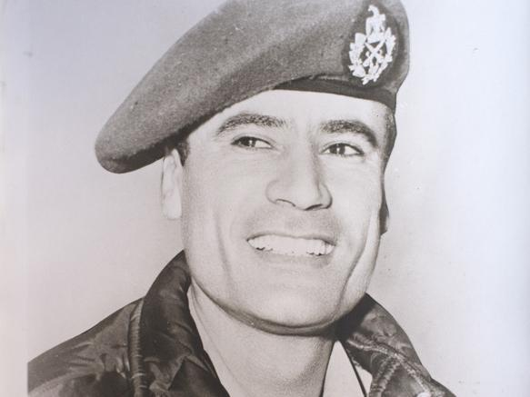 <p>A young Moammar Gadhafi smiles in an undated family photograph.</p>