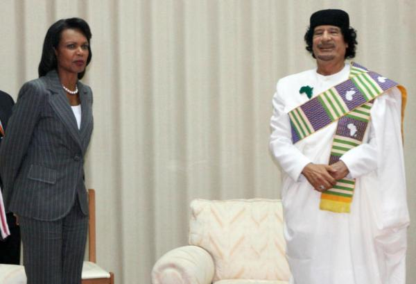 <p>Moammar Gadhafi (R) poses with U.S. Secretary of State Condoleezza Rice prior to a meeting in Tripoli on Sept. 5, 2008. </p>