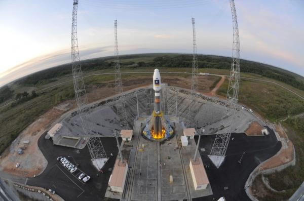 <p>In this handout image supplied by the European Space Agency (ESA), the Soyuz VS01 is prepared on the launch pad at the European Spaceport in Kourou, French Guiana.</p>