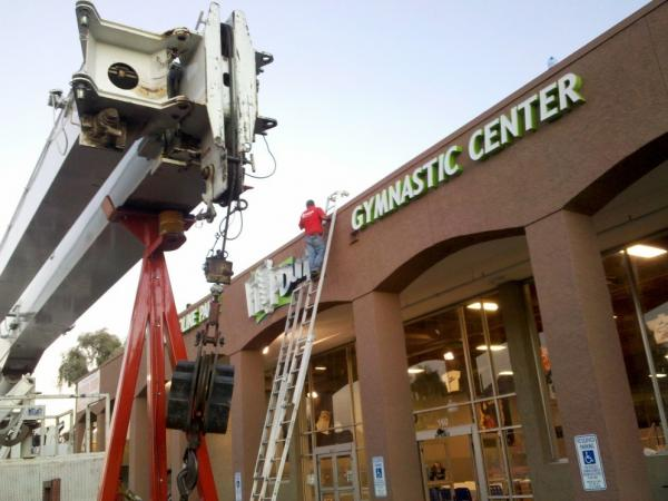 <p>Workers prepare for the opening of a gymnastics center at Bethany East, a Central Phoenix shopping complex that has emerged successfully from the recession.</p>