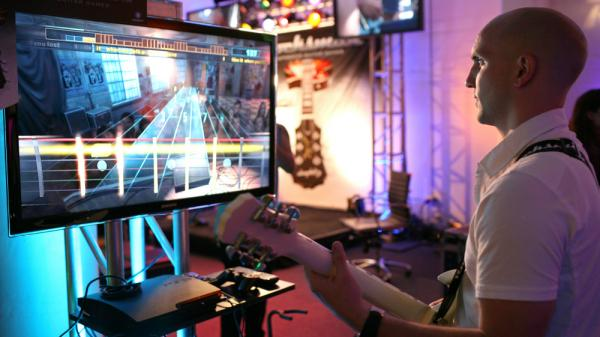 <p>Paul Cross, creative director of Rocksmith, plays the game at a demonstration event in San Francisco, Calif.</p>