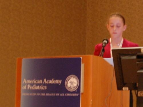 <p>Casey Gittelman present her study findings at a medical meeting in Boston.</p>
